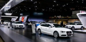 Audi stand with various Audi models on display during the 2014 Brussels motor show. The Audi A5 Sportback is standing in the forground whit the A4 and A4 Avant in the background.